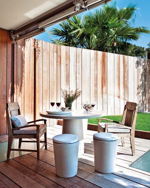 Comedor en el porche: suelo de madera