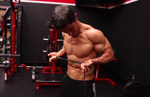 athlean x founder jeff cavaliere doing a banded curl