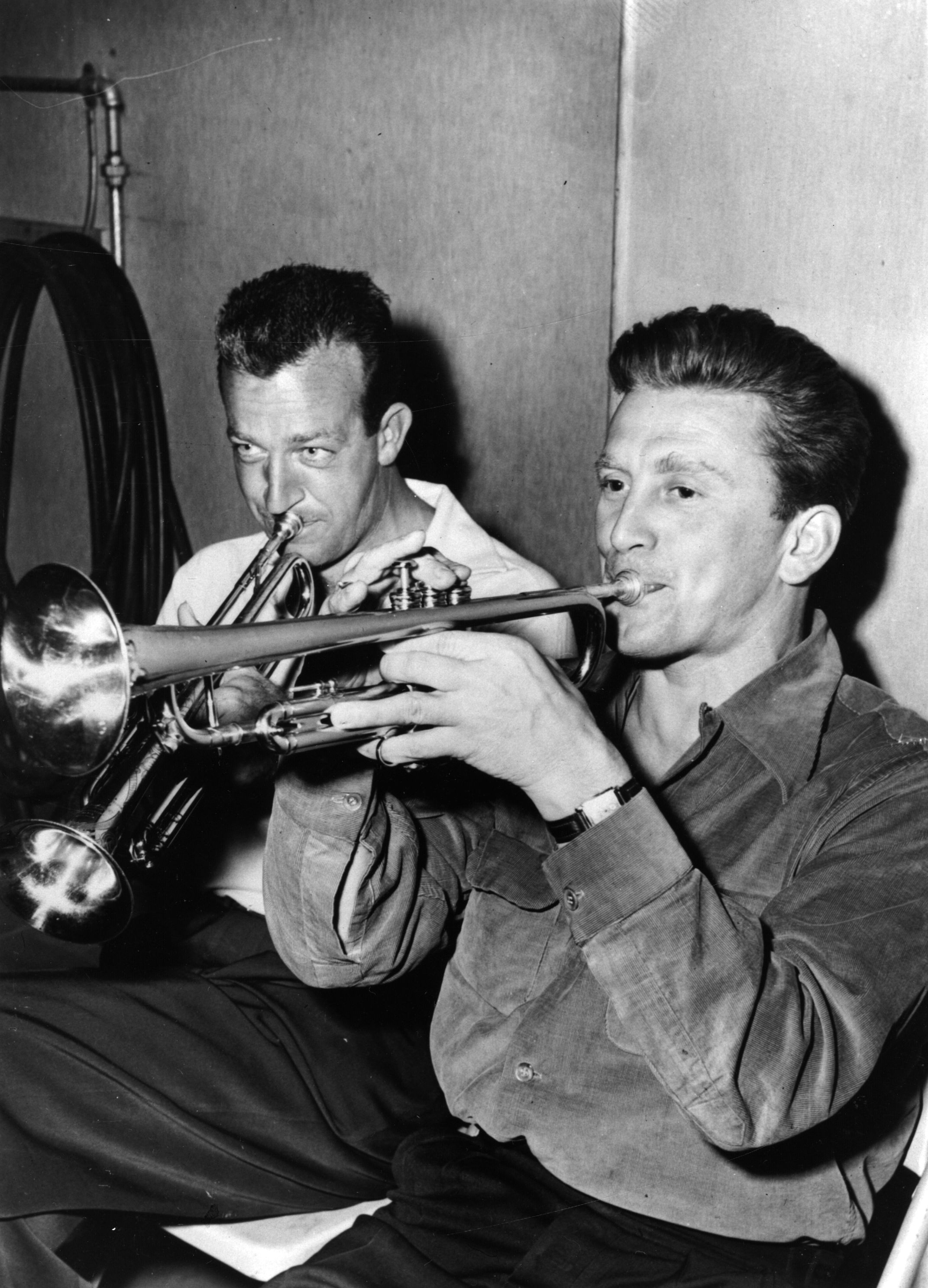Douglas plays the trumpet with bandleader and trumpeter Harry James.