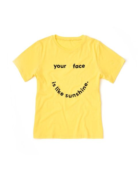 T-shirt, Clothing, Yellow, White, Product, Facial expression, Smile, Text, Font, Sleeve,