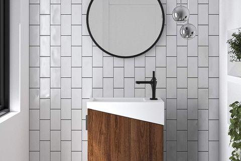 baño pequeño en blanco y negro con mueble de lavabo suspendido