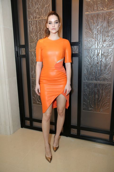 Clothing, Fashion model, Orange, Shoulder, Dress, Cocktail dress, Fashion, Yellow, Leg, Joint,