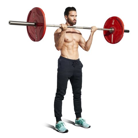 man with dark hair wearing black jogging trousers exercisingholding barbellsstanding biceps curl