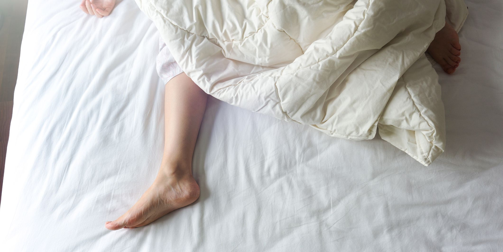 Bare feet on bed