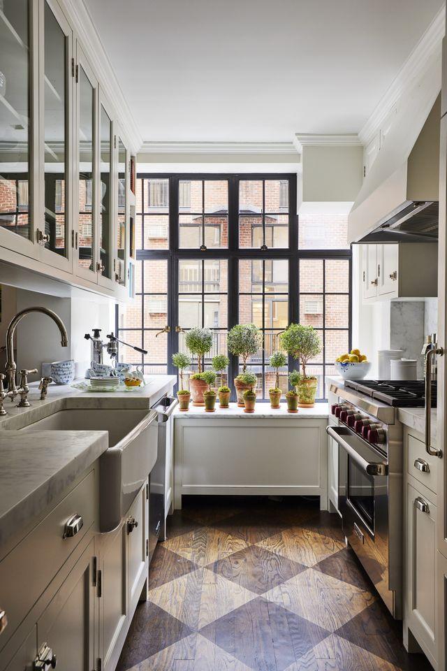 large steel casement windows in a galley kitchen