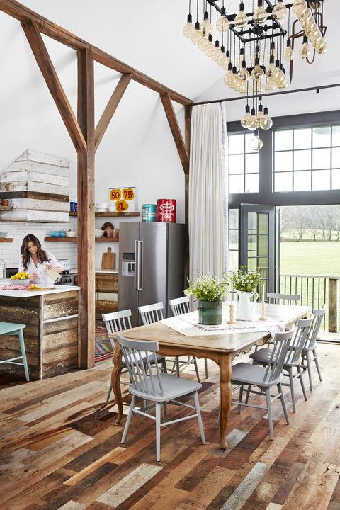 wood dining table and chairs in open dining room