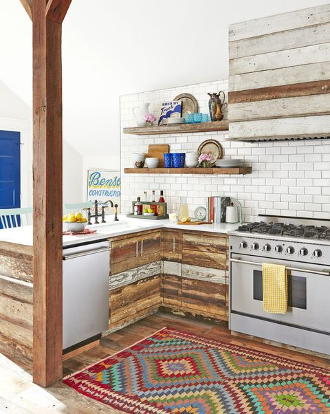 rustic modern farmhouse kitchen with reclaimed wood cabinets and vent hood