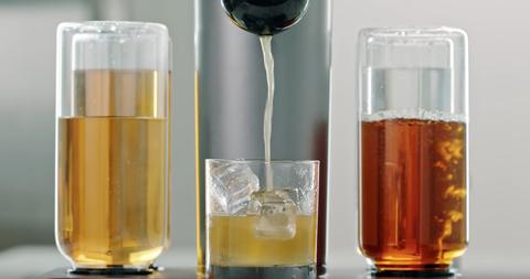 Drink, Glass bottle, Liquid, Beer glass, Caramel color, Glass, Pint glass, Bottle, Drinkware, Barware,