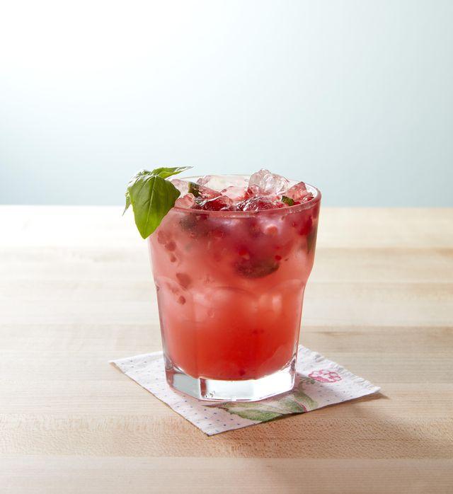 basil raspberry lemonade garnished with a basil sprig