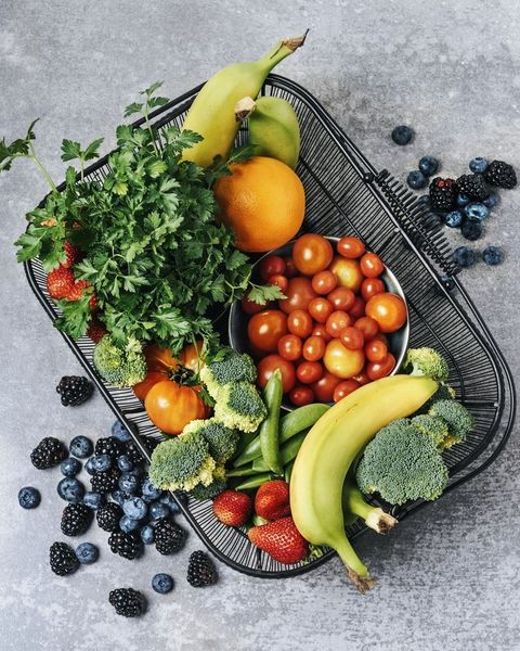 A basket of fresh vegetables, and fruits