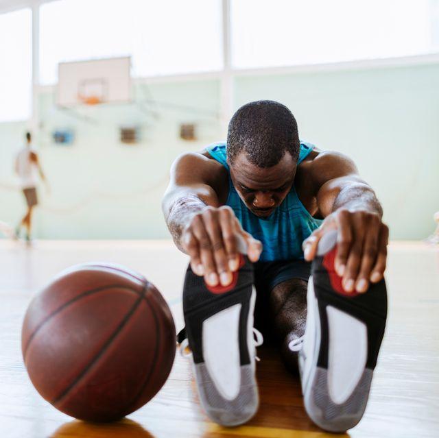 Basketball player stretching