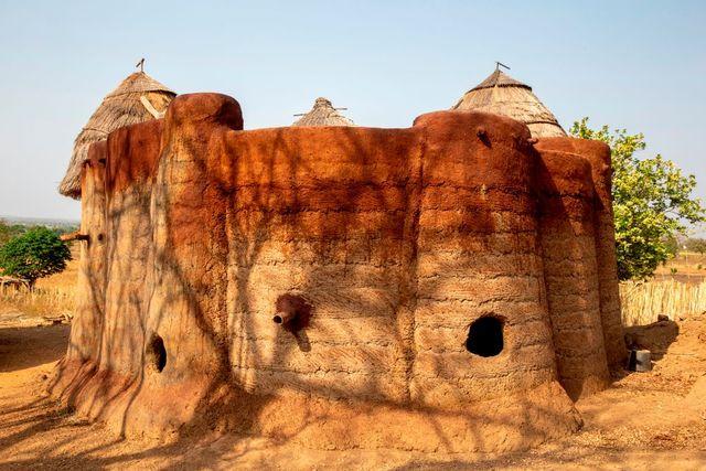 batammariba building in a koutammakou village in north togo