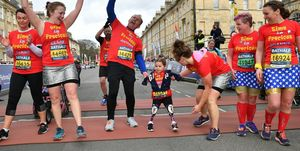 5 year old girl without limbs finishes bath half marathon