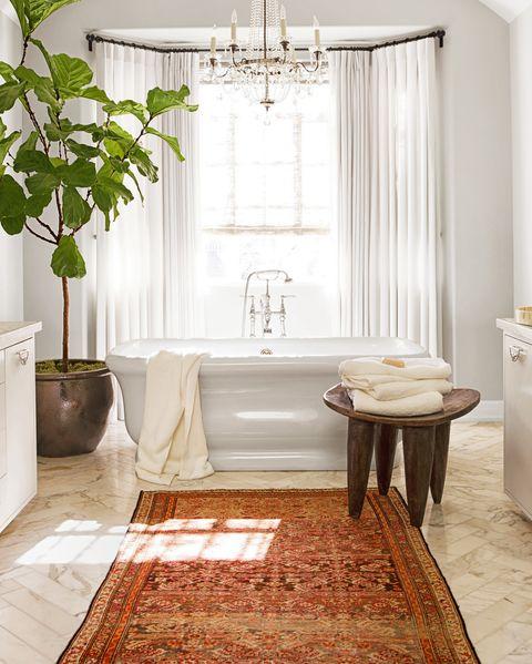 bathroom with fiddle leaf fig tree