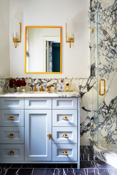 bathroom with blue vanity and marble