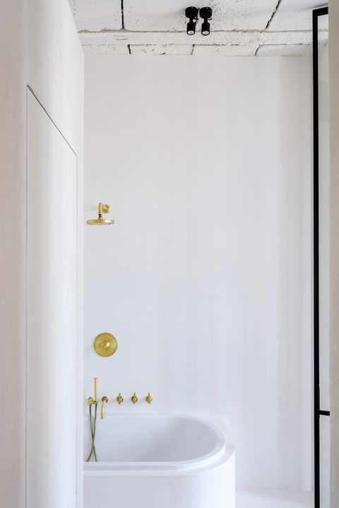 modern white bathroom without shower enclosure