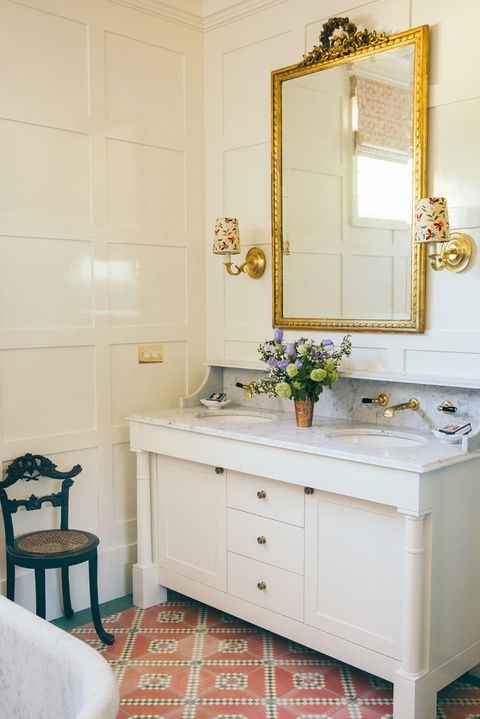 traditional formal bathroom with lampshade sconces