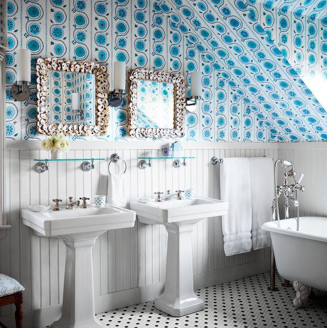 white preppy bathroom with blue wallpaper