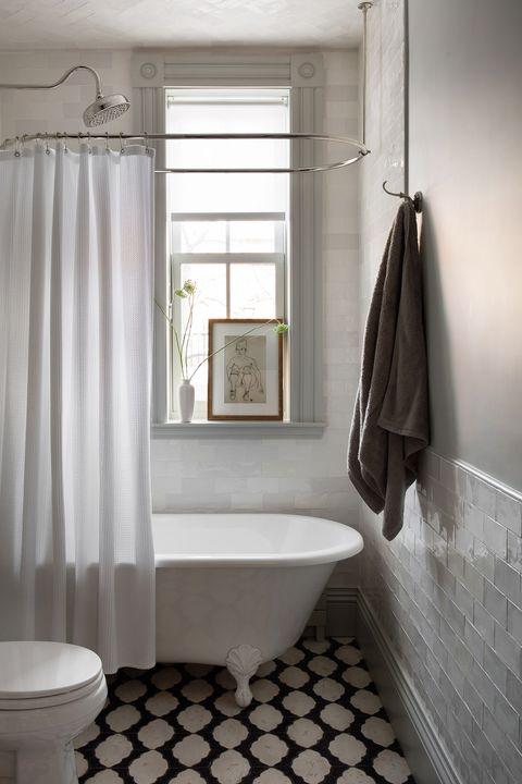 bathroom with window sill shelf