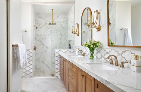 bathroom, white bathroom, marble countertop, wooden cabinets