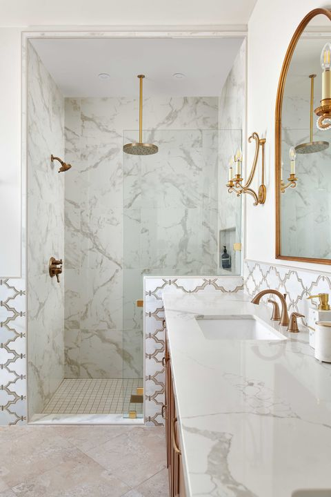 shower, marble countertops, gold faucets, gold mirrors, gold sconces