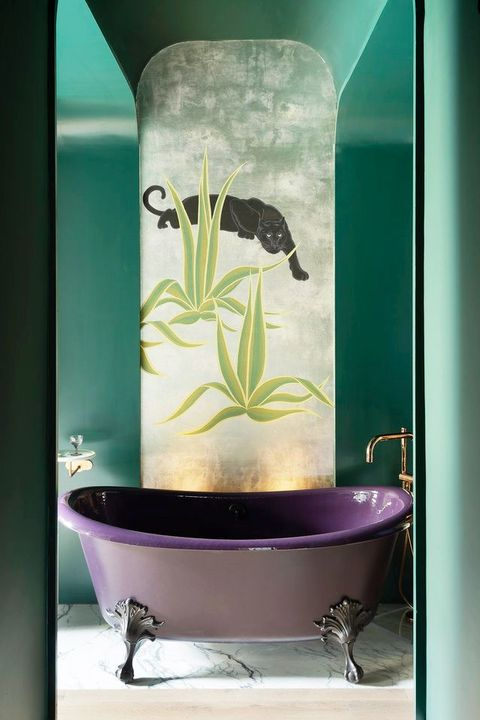 sexy bathroom with purple tub and mural wallpaper