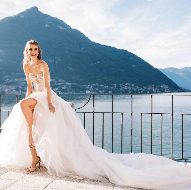 Clothing, Mountainous landforms, Dress, Bridal clothing, Photograph, Mountain range, Wedding dress, Happy, Highland, Bride,