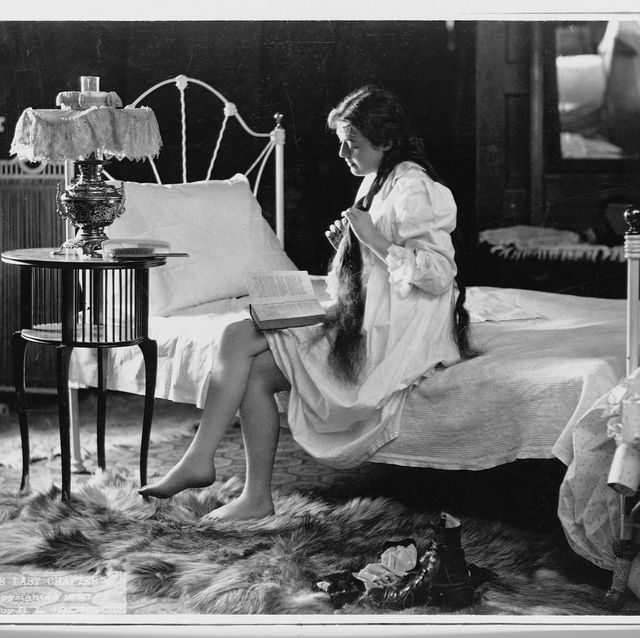 a young women in a nightgown reads a book in her bedroom, 1897   photo by as jacksonlibrary of congresscorbisvcg via getty images