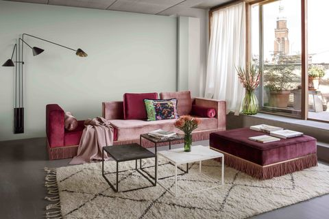 Ester Bruzkus' Berlin home, the velvet sofa in three hues of pink is her own design with Studio Coucou