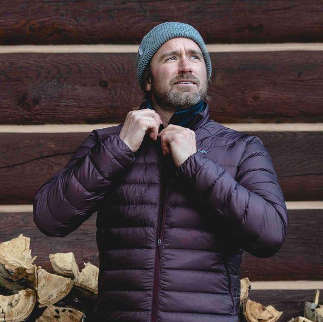 man zipping up backcountry jacket