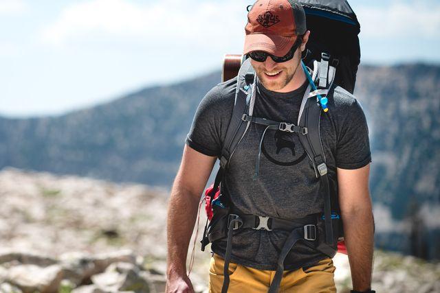 man hiking wearing backcountry gear