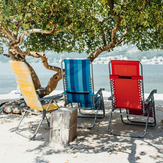 beach chairs next to coast