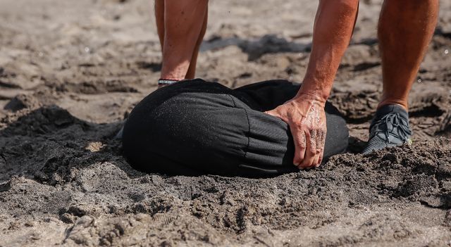 beach workout with sandbag