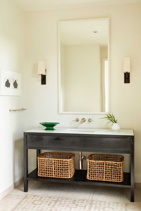 dark wooden console, white countertop, white painted walls