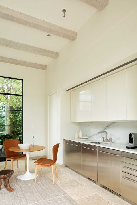 kitchen, stainless steel cabinets, marble countertop and marble backplast, stainless steel faucet