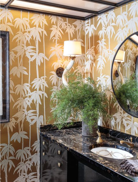 powder room with gold wallpaper