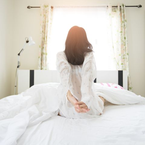 Beautiful Asian Girl lazy wake up in early morning