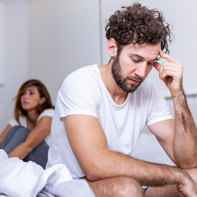 beautiful girl and a frustrated man sitting in bed and not looking at each other upset couple ignoring each other worried man in tension at bed young couple angry with each other after a fight
