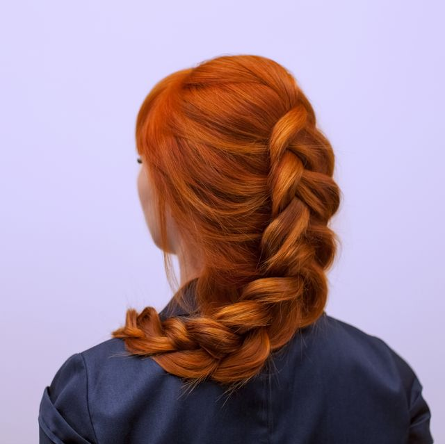 girl with long red hair, braided with a french braid