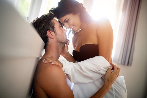 beautiful passionate couple in bedroom