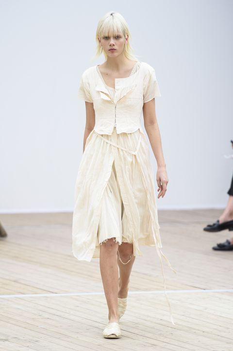Fashion model, White, Fashion, Runway, Fashion show, Clothing, Shoulder, Dress, Beige, Fashion design,