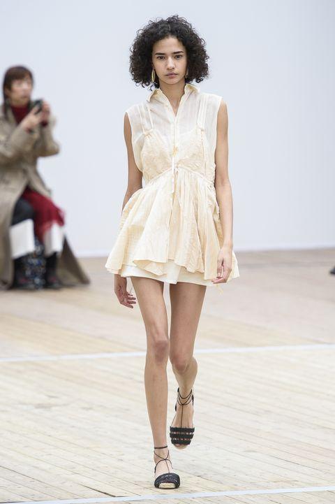 Fashion model, Fashion show, Fashion, Runway, White, Clothing, Fashion design, Beauty, Dress, Public event,