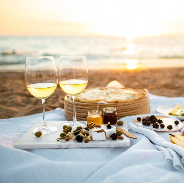 beautiful served picnic at seaside on sunset