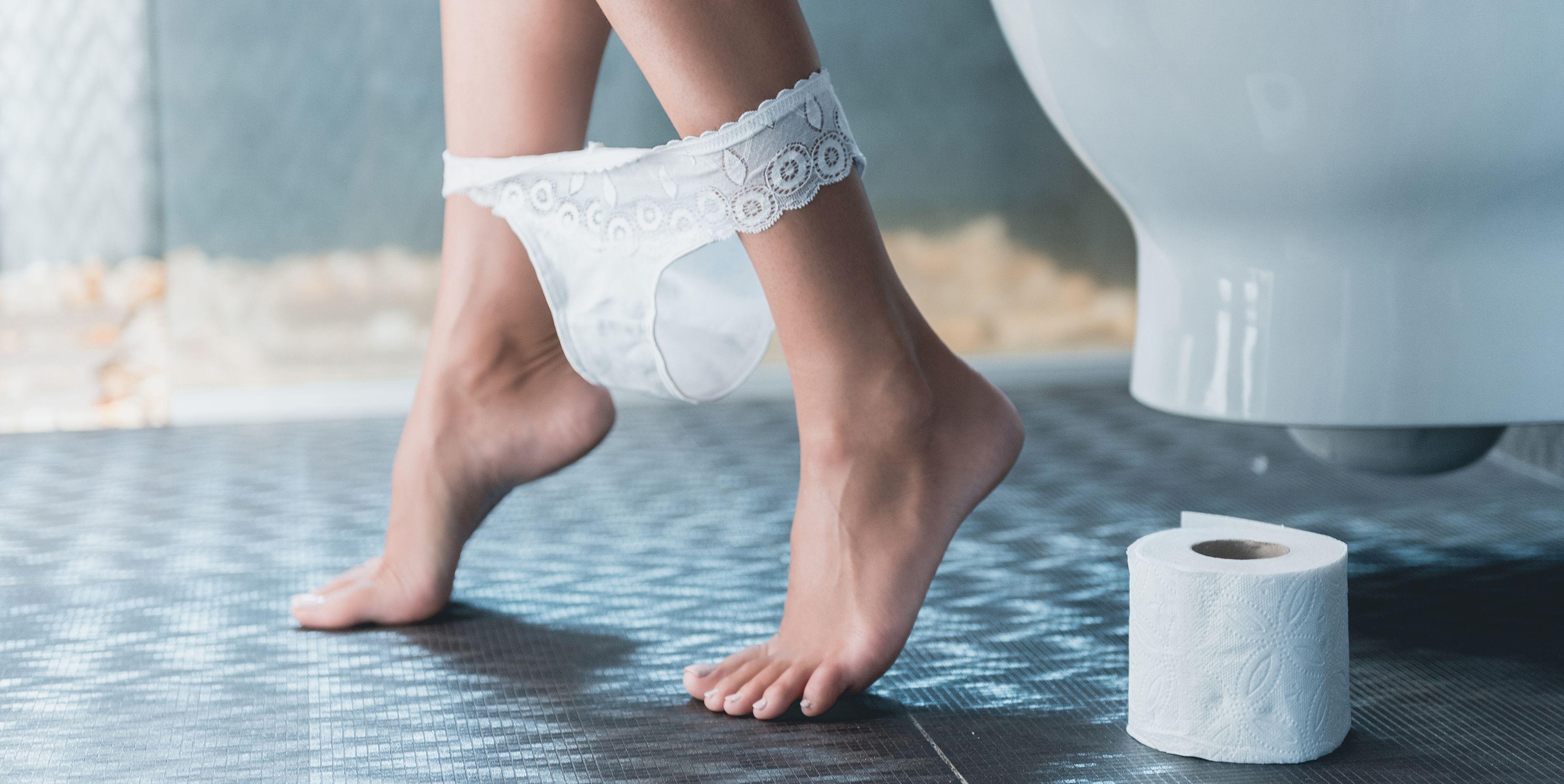 Beautiful Slender Legs of White Girl on Toilet.