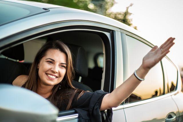 beautiful smiling girl in the car