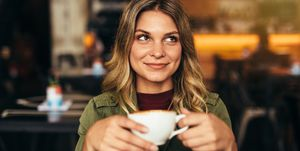 Beautiful woman at cafe with cup of coffee