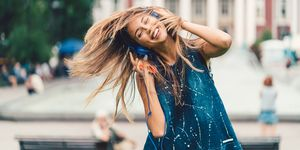 Beautiful woman tossing hair to the music
