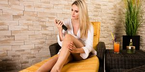 Beautiful woman treating her legs