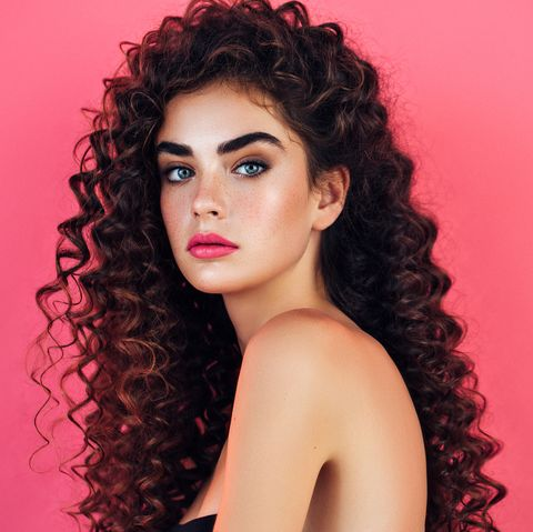 Beautiful woman with lush hairstyle