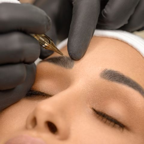 beautiful young woman receiving permanent make up